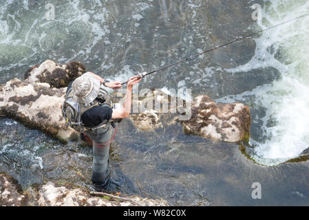 Aerial view of sport Fisher fishing in the river . - Stock Photo