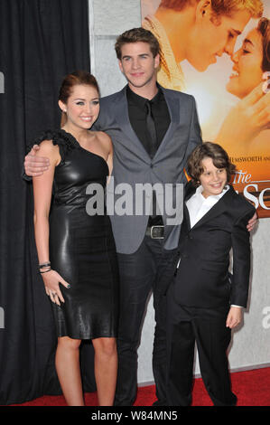 LOS ANGELES, CA. March 25, 2010: Miley Cyrus with Liam Hemsworth & Bobby Coleman (right) at the world premiere of their new movie 'The Last Song' at the Arclight Theatre, Hollywood. © 2010 Paul Smith / Featureflash - Stock Photo