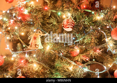 Beautiful decorated christmas tree with balls and bells. Holiday background - Stock Photo