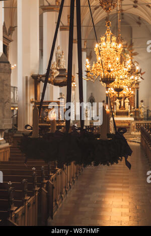 Catholic church interior with Christmas decoration and candles. The Trinitatis Church is located in central Copenhagen, Denmark. It is part of the 17t - Stock Photo