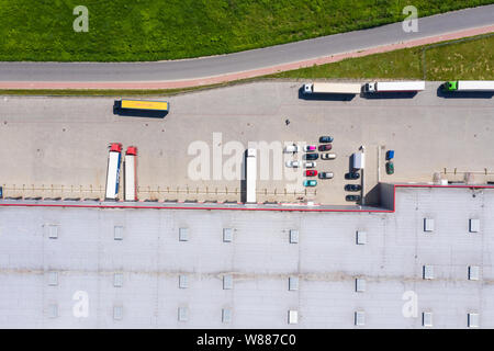 Aerial view of goods warehouse. Logistics center in industrial city zone from drone view. Background texture concept. - Stock Photo