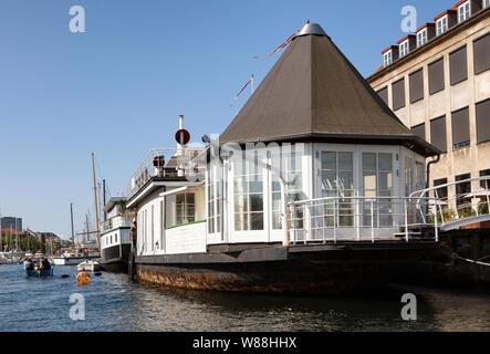 Houseboats in Christianshavn Copenhagen Denmark - canal scene with houseboat in summer, Christianshavn, Copenhagen Scandinavia Europe - Stock Photo