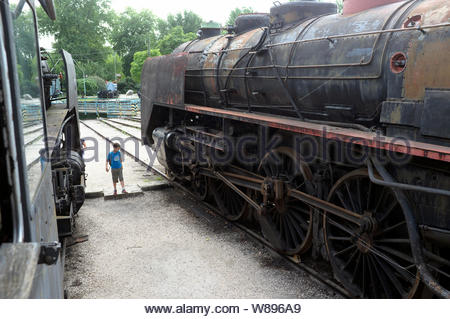 Old redundant steam locomotives at the Hungarian Railway Museum (Magyar Vasuttorteneti Park). Budapest, Hungary. - Stock Photo