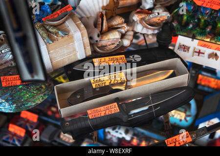 Southend on Sea, Essex, UK 9 August 2019. Knives for sale at a sea front retail shop. Despite protests from local residents in Southend knives are still being openly displayed for sale in the shop window of Gaiety Bazaar, a gift shop on Pier Hill  on Southend sea front. Credit: BRIAN HARRIS/Alamy Live News - Stock Photo