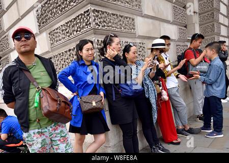 London, England, UK. Group of Japanese tourists in Whitehall - Stock Photo