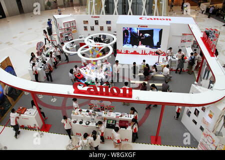--FILE--People visit the stand of Canon during a promotional event in Wuhan city, central China's Hubei province, 3 May 2015.    Japans Canon Inc on T - Stock Photo