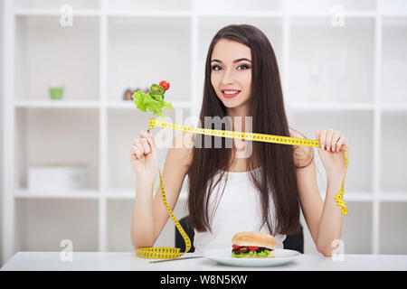 Diet. Healthy eating, dieting, slimming and weigh loss concept. Dieting concept. Weight Loss. The measuring tape is wrapped around the arm. In the - Stock Photo
