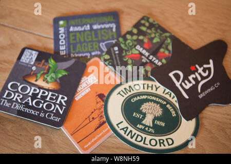 A Selection of Beer Mats - Stock Photo