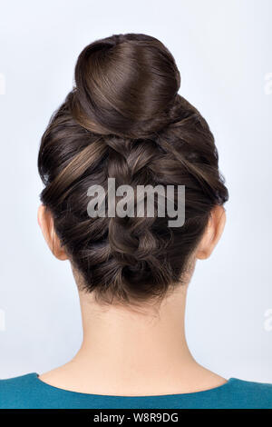 Modern Hairstyle For Long Hair Reverse Braided Bun Upside