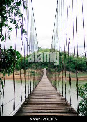 Wooden bridge across the river, Suspension bridge, Bridge in Kaeng Krachan National Park, Phetchaburi Thailand - Stock Photo