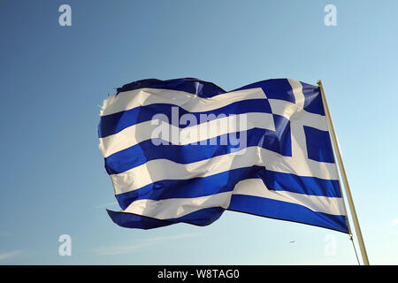 12 June 2019, Greece, Mykonos: The Greek flag is flying on the roof of a house. Photo: Soeren Stache/dpa-Zentralbild/ZB - Stock Photo