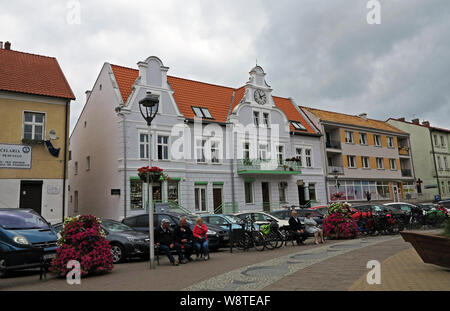 Restored civil houses from the pre-war period on the market in the town of Mikolajki (Nikolaiken) in the Polish Masuria (former East Prussia), recorded on 18.07.2019 | usage worldwide - Stock Photo