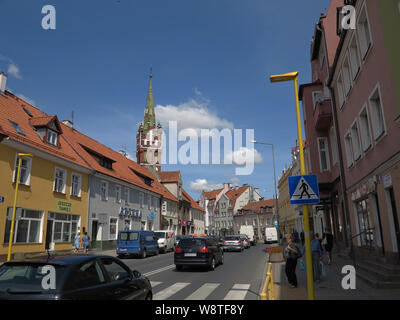 View of citizens' houses in the town of Ketrzyn (Rastenburg) in the Polish Masuria (formerly Ostpreussen) - in the background the neo-gothic church of St. Katharina, recorded on 15.07.2019   usage worldwide - Stock Photo