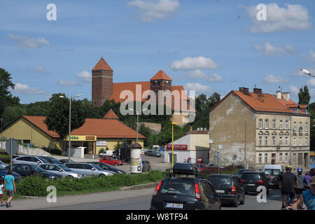 View on Buergerhaeuser from the pre-war period and the fortified church (1370) in the city Ketrzyn (Rastenburg) in the Polish Masuria (former Ostpreussen), recorded on 15.07.2019   usage worldwide - Stock Photo