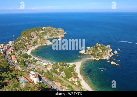 Beautiful aerial view of Taormina, Italy. Sicilian seascape with Isola Bella island and beach. - Stock Photo