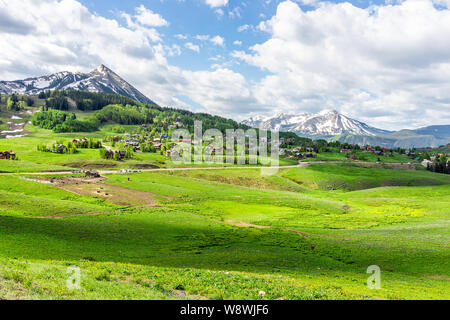 Crested Butte, Colorado Snodgrass hiking trail in summer with alpine meadows and mountain view and town village - Stock Photo