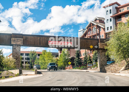 Mount Crested Butte, USA - June 20, 2019: Colorado village in summer with entrance and signs to houses on hill on Gothic Road - Stock Photo