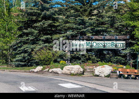 Mount Crested Butte, USA - June 20, 2019: Colorado village in summer with entrance welcome sign on Gothic Road - Stock Photo
