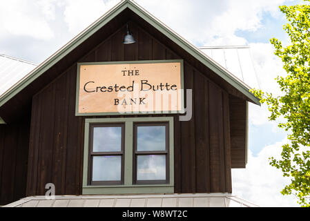 Mount Crested Butte, USA - June 20, 2019: Colorado village town downtown in summer with sign for bank exterior - Stock Photo