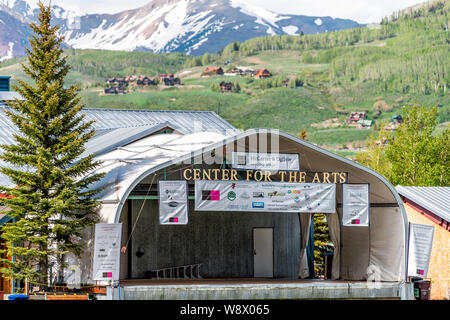 Mount Crested Butte, USA - June 20, 2019: Colorado village in summer with sign on road for center for the arts stage - Stock Photo