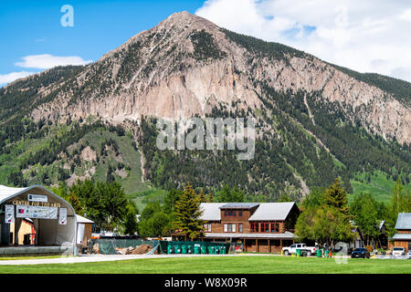 Mount Crested Butte, USA - June 20, 2019: Colorado village in summer with park and sign on road for center for the arts stage - Stock Photo