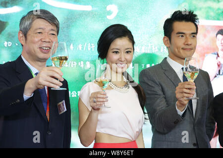 Taiwanese actress Ruby Lin, center, and actor Weber Yang, right, toast at a press conference for their new TV series, The Way We Were, during the 20th - Stock Photo