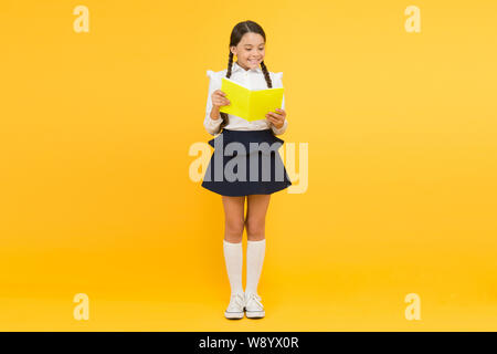 Towards knowledge. Learn following rules. Welcome back to school. School lesson. Study literature. Inspirational quotes motivate kids for academic year ahead. School girl formal uniform hold book. - Stock Photo