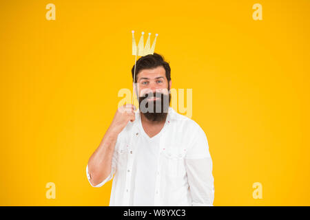 Birthday boy. Guy in yellow background posing with booth props. Photo booth fun. Bearded man king costume party. Handsome bearded guy king. King of party. Costume party. Holiday carnival celebration. - Stock Photo