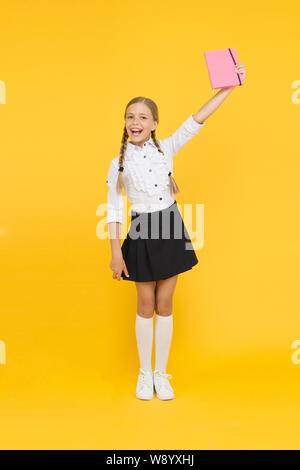 Study literature. Towards knowledge. Learn following rules. Welcome back to school. Inspirational quotes motivate kids for academic year ahead. School girl formal uniform hold book. School lesson. - Stock Photo