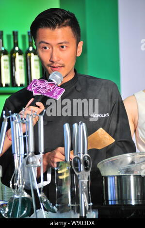 Hong Kong singer and actor Nicholas Tse speaks at a promotional event for Olivoila olive oil in Hangzhou city, east Chinas Zhejiang province, 24 Augus - Stock Photo