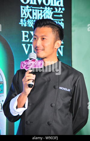 Hong Kong singer and actor Nicholas Tse listens during a promotional event for Olivoila olive oil in Hangzhou city, east Chinas Zhejiang province, 24 - Stock Photo