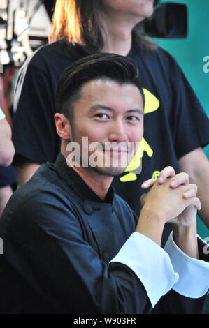 Hong Kong singer and actor Nicholas Tse attends a promotional event for Olivoila olive oil in Hangzhou city, east Chinas Zhejiang province, 24 August - Stock Photo