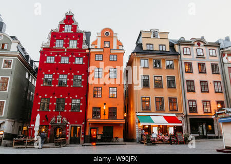 Stockholm, Sweden June 7 2019: Old colorful houses on the square Stortorget in Gamla Stan. - Stock Photo