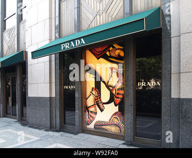 --FILE--View of a Prada store in Shanghai, China, 23 March 2011.   Prada, Italys luxury goods powerhouse, said global sales were softer in the first w - Stock Photo