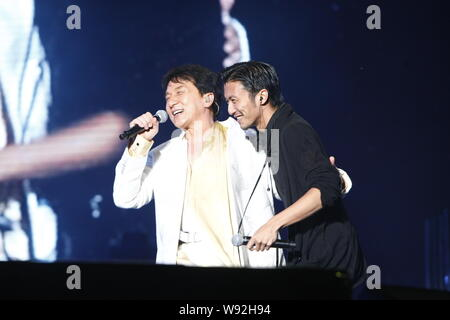 Hong Kong actor and singer Jackie Chan, left, performs with Hong Kong actor and singer Nicholas Tse during Chans concert in Hangzhou, east Chinas Zhej - Stock Photo