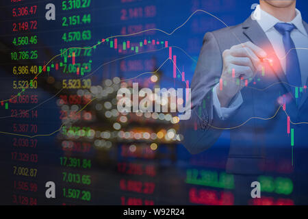 Graph of stock market data and financial with indicator, pricing display on offshore oil and gas processing platform background for world energy and o - Stock Photo