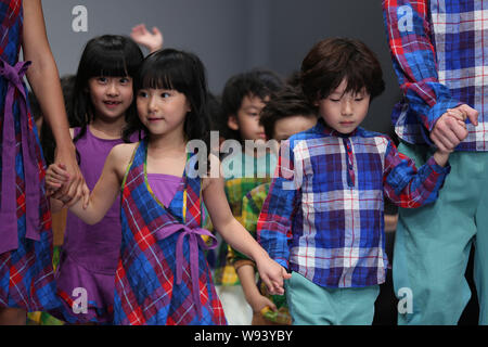 Young models display a new creation at the Kelkel fashion show during the Shanghai Fashion Week Spring/Summer 2014 in Shanghai, China, 20 October 2013 - Stock Photo