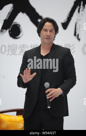 Canadian actor Keanu Reeves waves at a press conference of the new movie, Man of Tai Chi, in Beijing, China, 20 June 2013. - Stock Photo