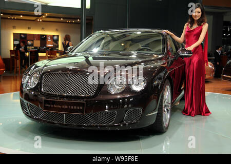 --FILE--A model poses with a Bentley Continental Flying Spur during the 9th China (Guangzhou) International Automobile Exhibition, known as Auto Guang - Stock Photo