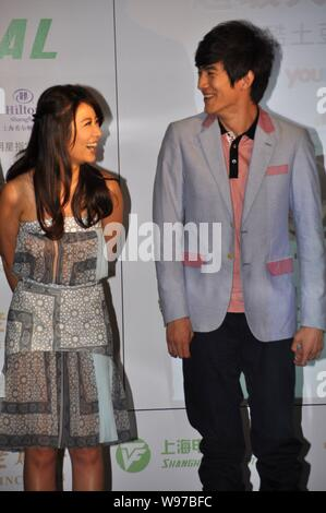 Taiwanese actress Ruby Lin and Chinese actor Lin Gengxin giggles during the press conference for a new micro movie in Shanghai, China, 12 June 2012. - Stock Photo
