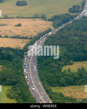 An aerial view of heavy traffic on the M25, Essex, South East England, UK - Stock Photo