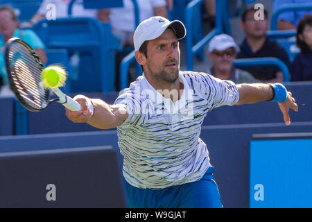 Mason, Ohio, USA. 13th Aug, 2019. NOVAK DJOKOVIC of Serbia returns a shot during Tuesday's round of the Western and Southern Open, at the Lindner Family Tennis Center. Credit: Scott Stuart/ZUMA Wire/Alamy Live News - Stock Photo