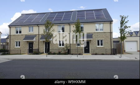New contemporary sustainable low energy housing development with solar panels, rainwater harvesting, triple glazing, and attractive community spaces - Stock Photo