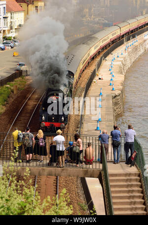 The English Riviera Express passing through Dawlish, hauled by West Country class pacific No 34046 'Braunton'. - Stock Photo
