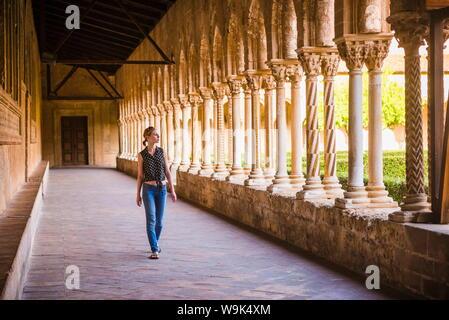 Tourist at Monreale Cathedral (Duomo di Monreale) in courtyard gardens, Monreale, near Palermo, Sicily, Italy, Europe - Stock Photo