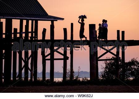 Sunset over U Bein Bridge, Taungthman Lake, U Bein, Amarapura, Myanmar (Burma), Asia - Stock Photo