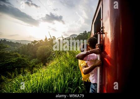 Riding the train in Sri Lanka, Asia - Stock Photo