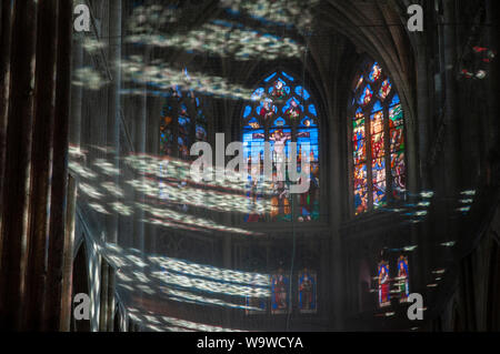 sunlight and shadows playing on the safety net below the ceiling in Saint-Jacques church in Dieppe, France. - Stock Photo