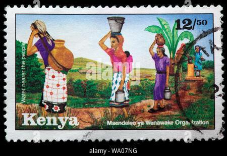 Water bearer, postage stamp, Kenya, 1994 - Stock Photo