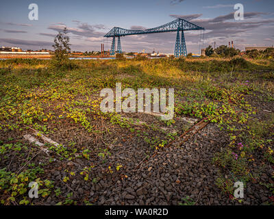 Middlesbrough Transporter Bridge at sunrise. The Bridge carries people and cars over the River Tees in a suspended gondola - Stock Photo